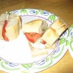 sandwich on sourdough bread and a paper plate