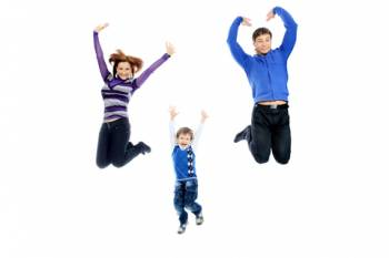 two parents and a boy jumping