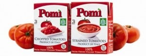 Pomi boxed tomatoes with real tomatoes on the side