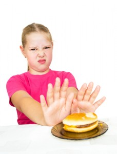 girl refuses hamburger isolated on white