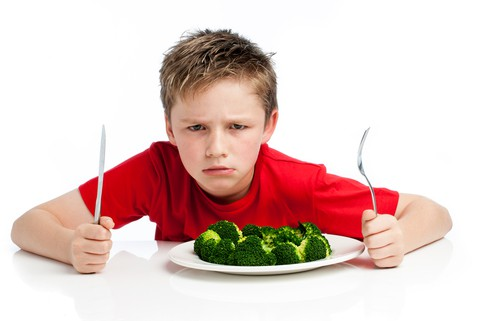 http://www.dreamstime.com/royalty-free-stock-image-handsome-young-boy-eating-broccoli-grumpy-plate-white-background-image32210686