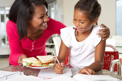 http://www.dreamstime.com/stock-photo-mother-brings-daughter-sandwich-whilst-studies-smiling-image31165180