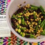 Trader Joe's recipe for salad next to a bowl of green beans, almonds, and garbanzo beans