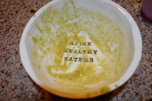 an empty bowl of soup on the counter with raise healthy eaters text
