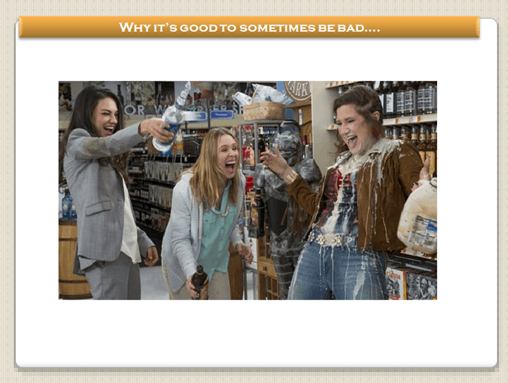 bad moms movie when they are in the grocery store opening champagne and laughing