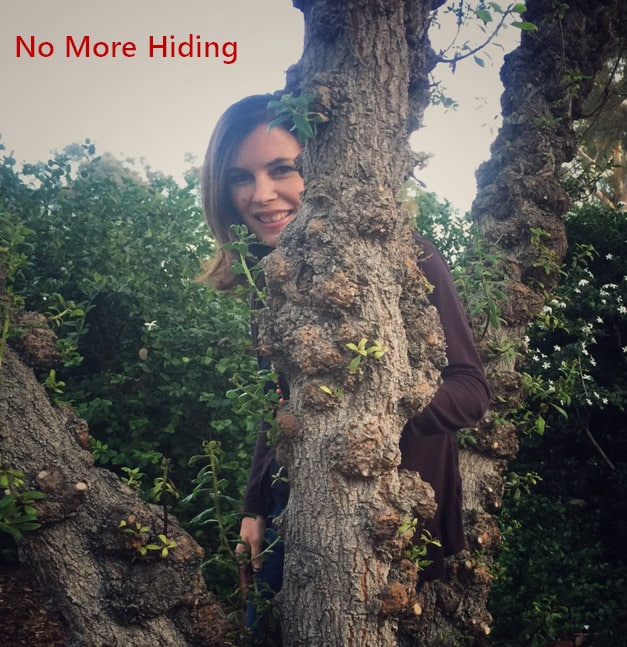 """Maryann outside behind a tree with the caption """"No More Hiding"""""""