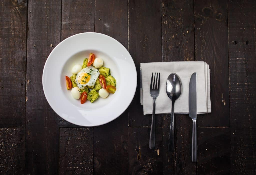 A simple meal white plate and place setting