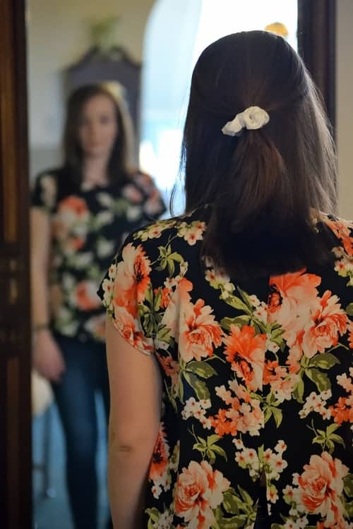 girl standing in front of the mirror