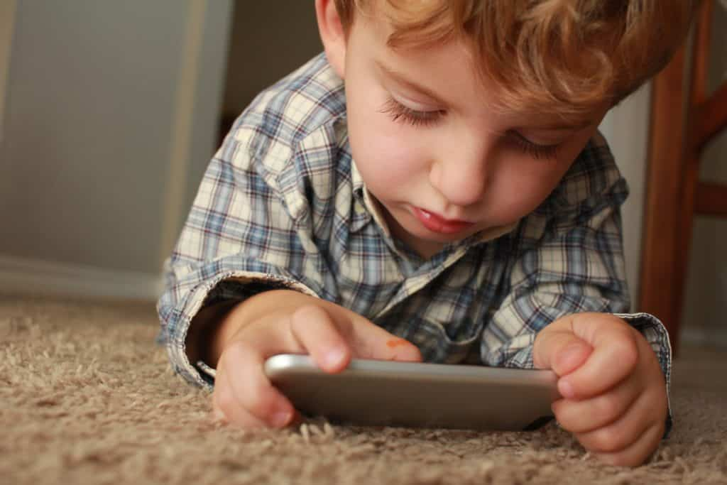 Toddler playing on his tablet