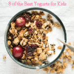cup of yogurt topped with granola and fruit with post title