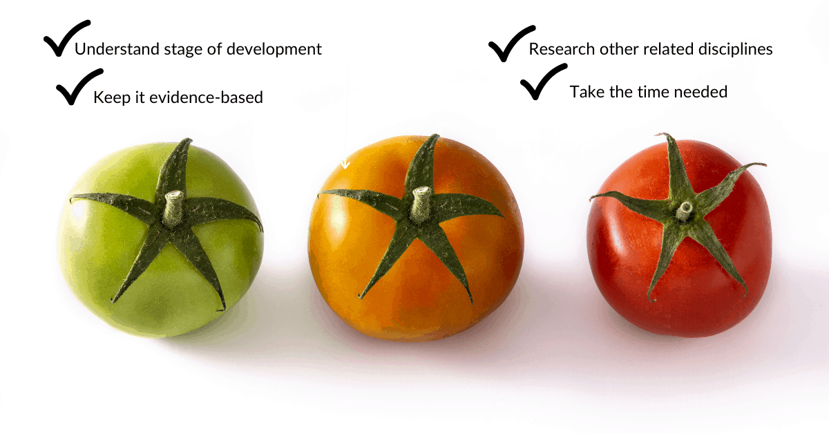three different colored tomatoes with a white background