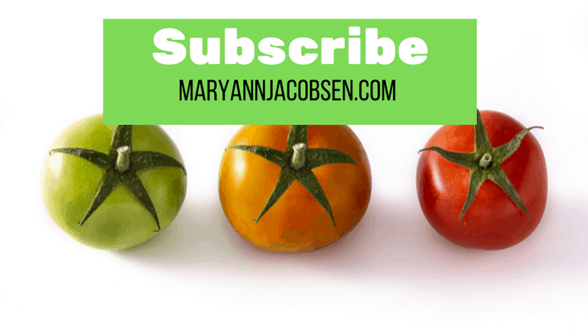 three tomatoes of different colors with white background