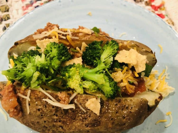 baked potato loaded with chili, broccoli, cheese and chips